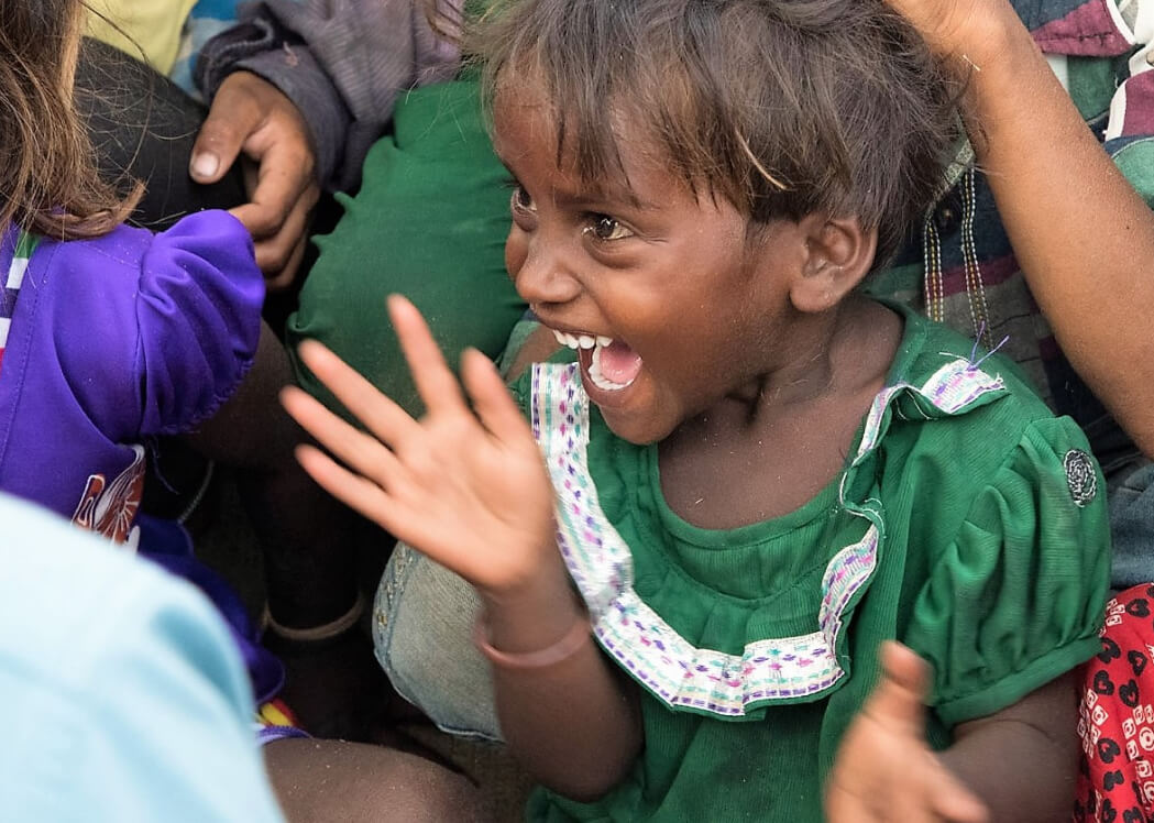 little girl laughing with joy